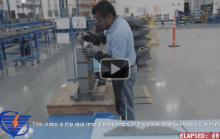 Video frame image of Corefficient employee disassembling a transformer core top yoke.