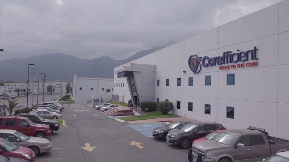An image showing the exterior of Corefficient's manufacturing facilities with Monterrey, MX mountains in the background.