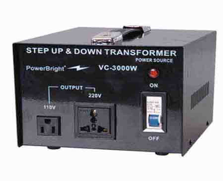 """A small, black step up and step down transformer, with a power button and red light to signify power, a 110V output outlet, a 220V, output outlet, and white text that reads: """"Step up and down transformer, power source, PowerBright, a horizontal lightning bolt logo, and VC-3000W."""""""