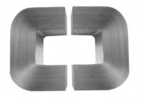 """Two stacks of silver-colored amorphous steel metal, in the shape of a """"u,"""" facing one another, forming an open oval."""